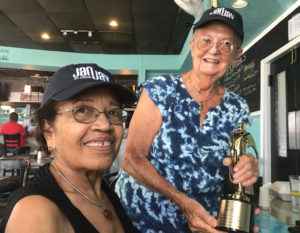 Roberta Knowles, left receives a gold trophy from Joan Keenan for her work on 'Proudly We Served.' (Photo by Elisa McKay)