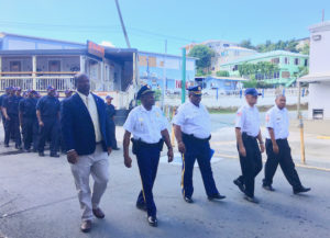 STJ officials lead fire cadets through Cruz Bay for the 9/11 commemoration, (Source photo by Amy Roberts)