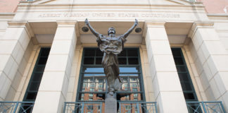 "A statue of ""Blind Justice"" graces the entrance to the Albert V Bryan U.S. Courthouse in Alexandria, Virginia, where Scott MacKenzie pled guilty to election law violations. (Shutterstock image)"