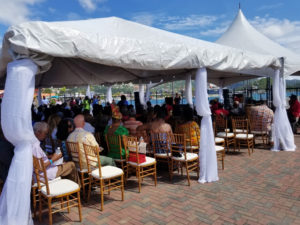 The audience sits under large tents in the center of Crown Bay's Austin Monsanto Terminal for the speeches and engertainment. (Source photo by Bethaney Lee)