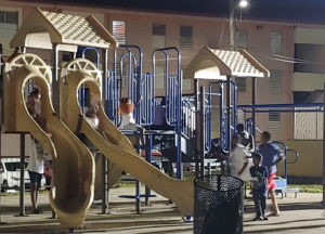 Children find solace in play at vigil. (Source photo by Shaun Pennington)