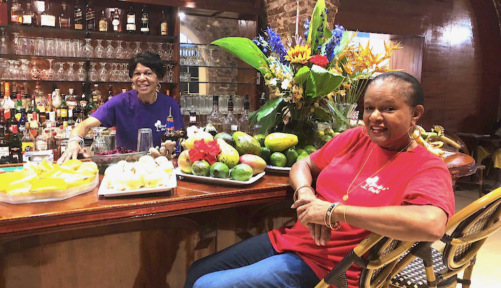 Pauline Alexander, left, and proprietor Gladys Isles-Jones welcome customers to Gladys' Cafe in the restaurant's new Royal Dane Mall location. (Source photos by Teddi Davis)