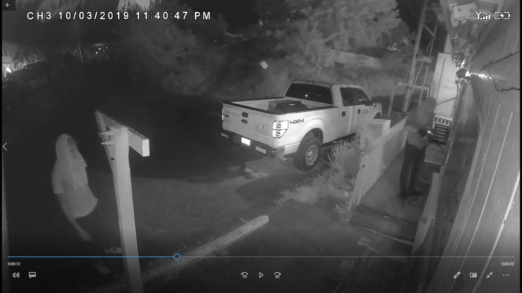 Image from the security camera at the Animal Care Center shows two men breaking into a nearby car rental company on Oct. 3.