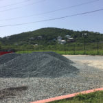 one of the piles of gravel ready to be spread across the parking lot. (Source photo by Amy Roberts)