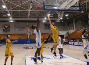 Ermias Nega, who scored 35 points against University of Baymon, goes in for a layup during the game. (Source photo by Kyle Murphy)