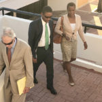 Defendant Amos Carty Jr. leaves Superior Court Thursday, accompanied by his wife, Verna and Attorney Gordon Rhea. (Source photo by Judi Shimel)