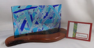 """Laura Marie Forbes """"Picking up the Pieces"""" glass piece and Madras Christmas card. (Submitted photo)"""