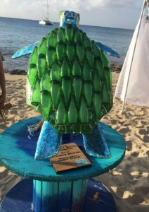 The back of Marilyn Hodges's turtle is partly decorated with half-bottles. (Source photo by Susan Ellis)