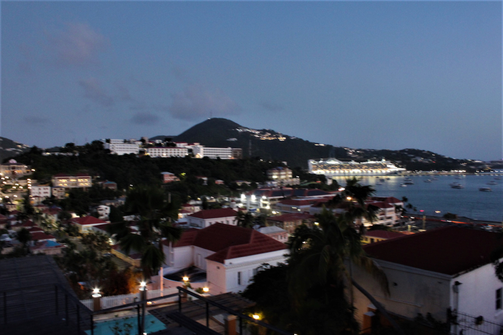 The expansive deck that hugs three of the home's exterior walls offers an expansive view of Charlotte Amalie. (Source photo by Bethaney Lee)