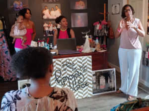 Yvonne Galiber addresses the guests at MGFC Breast Cancer Event. (Source pgoto by Denise Lenhardt-Benoit)