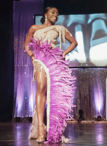 First runner-up Allayeah John-Baptiste models her high-fashion gown in Saturday's queen contest. (Source photo by Melody Rames)