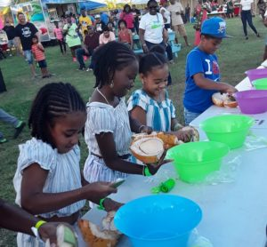 Children take part in the scooping contest. (Source photo by Darshania Domingo)