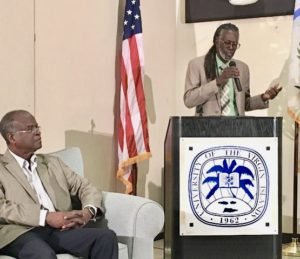 Valdemar Hill listens to Agriculture Commissioner Positive T. A. Nelson at Friday's cannabis forum. (Source photo by Susan Ellis)