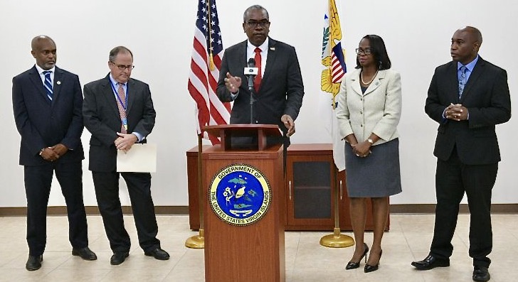 Surrounded by his team, Gov. Albert Bryan, Jr. addresses frustrations about an upcoming WAPA base rate increase, which he said will actually not affect customers' bills. (Source photo by James Gardner)