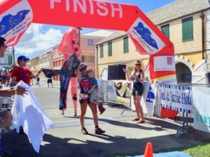 Ester Ellis carries her baby across the finish line Sunday. (Source photo by Susan Ellis)