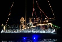 A brightly decorated boat takes part in the annual Christiansted Holiday Boat Parade. (Source photo by Don Buchanan)