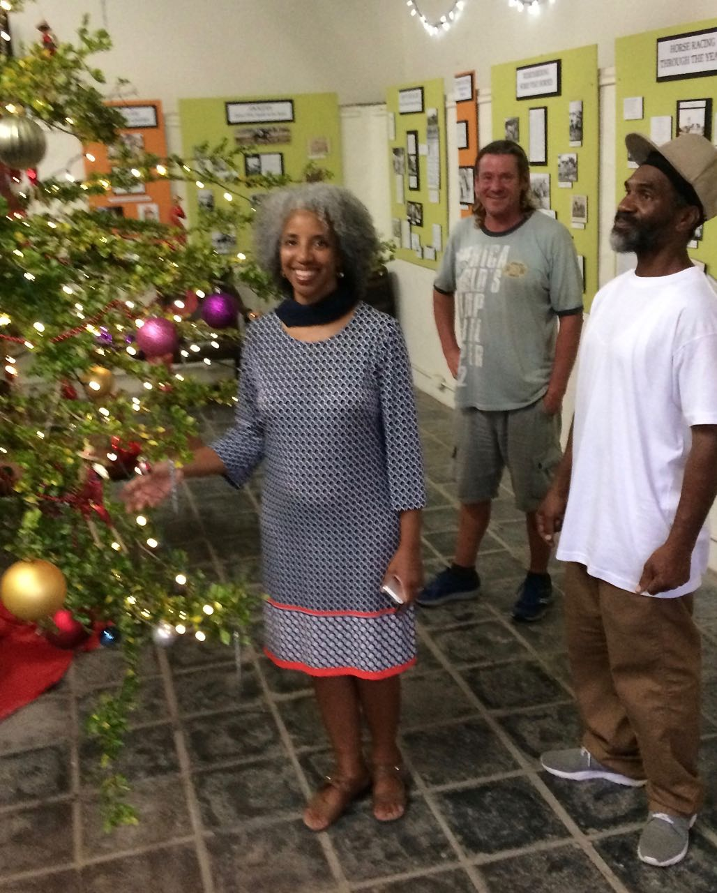 From left, Sonia Jacobs Dow, volunteer Chris Deiser and Anthony Alfred by the Inkberry Tree. (Source photo by Don Buchanan)