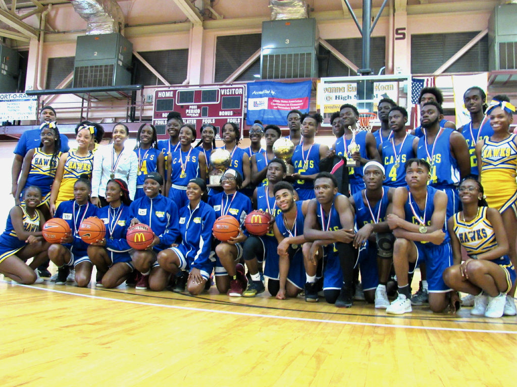 The girls and boys basketball teams celebrate winning both halves of the IAA/McDonald's Martin Luther King Memorial Invitational Boys and Girls Basketball Tournament
