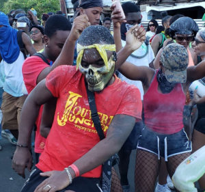 The J'ouvert Junction troupe dances down the route. (Source photo Melody Rames)