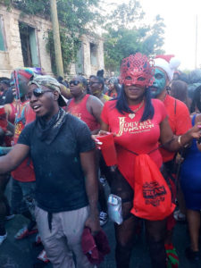 Masked revelers stream through town. (Source photo by Melody Rames)