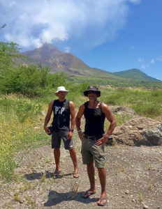 1. Patrick, left, and Steve Bennett stand beneath the Soufrière Hills Volcano in Montserrat.