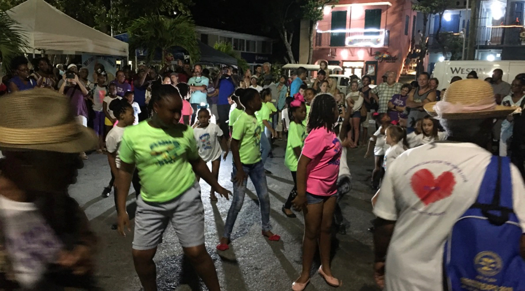 Dancers take to the streets of Cruz Bay. (Source photo by Amy Roberts)