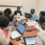 JFL administrative staff join board member Dr. Olivine Treasure for a Territorial Hospital Board meeting. (Source photo by Susan Ellis)