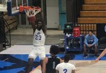 Muhammadu Jawuru slams the ball home for UVI. (Source photo by Kyle Murphy)