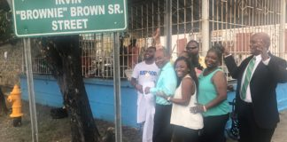 "Friends, family and admirers see unveiling of new sign naming Irvin ""Brownie"" Brown Sr. Street in September."