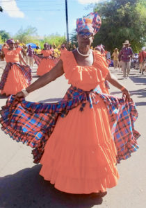 A modestly dressed parade participant. (Source photo by Carol Buchanan)