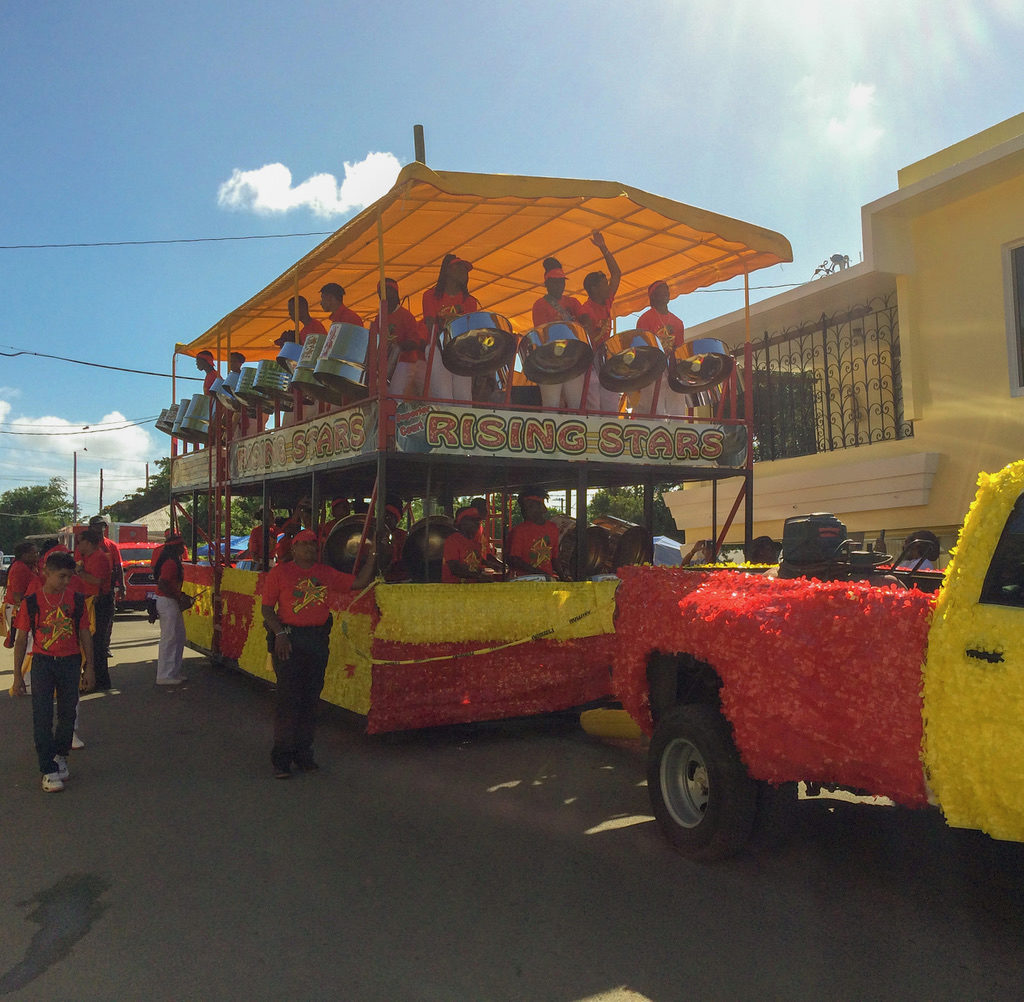 The Rising Stars steel orchestra rocks and rolls down the parade route. (Source photo by Don Buchanan)
