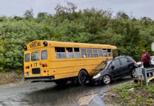 A school bus and a private vehicle are locked together after an accident on Cassie Hill. (Photo supplied by a Source reader)