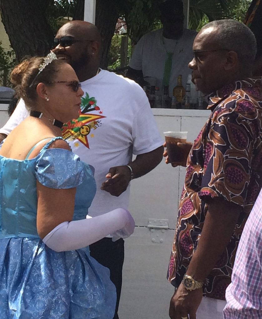 Sue Lakos talks with Gov. Albert Bryan on the parade route. (Source photo by Don Buchanan)
