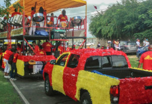 Participants in the 2019-2020 Crucian Christmas Festival Parade wait neat Claude O. Markoe School for the parade to finally get going. (Source photo by Don Buchanan)