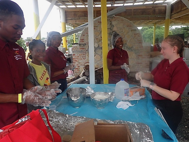 The Ivanna Eudora Kean culinary arts academy members work on a coal pot meal and Johnny cakes. (Source photo by Susan Ellis)