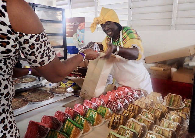 LaVerne Bates sells cake after winning prizes in several categories on Saturday. (Source photo by Susan Ellis)