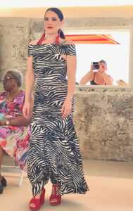 Courtney Mills models a zebra print maxi dress from MGC. (Source photo by Elisa McKay)