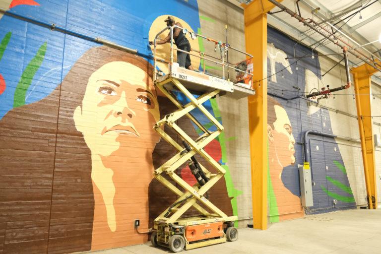 St. Croix Native Paints Mural in Honolulu, Celebrating Hawaiian Culture
