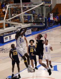 Muhammadu Jawaru dunks the ball over a Carver Cougar defender. (Source photo by Kyle Murphy)