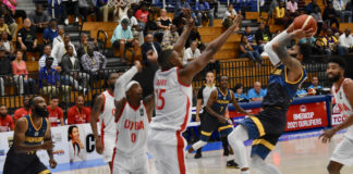 Walter Hodge battles through Cuban defenders to throw up a shot in Monday's game. (Source photo by Kyle Muprhy)