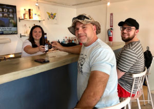 Bartender Joanne Adams serves up ice cold beer to cruise ship passengers Mark Lotthammer and John Cox of Sarasota, Florida at The Pelican Shop. (Source photos by Teddi Davis)