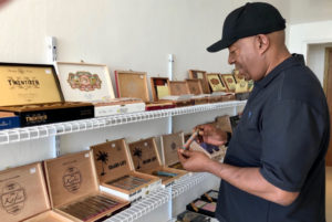 Al Williams of Colorado Springs peruses a selection of cigars on display at The Pelican Shop on the waterfront in downtown Charlotte Amalie. (Source photos by Teddi Davis)