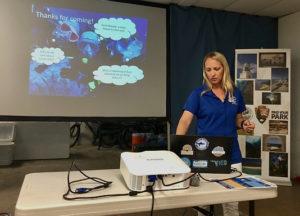 Erin Muller of the Mote Marine Laboratory talks about coral reef diseases last week. (Source photo by Susan Ellis)