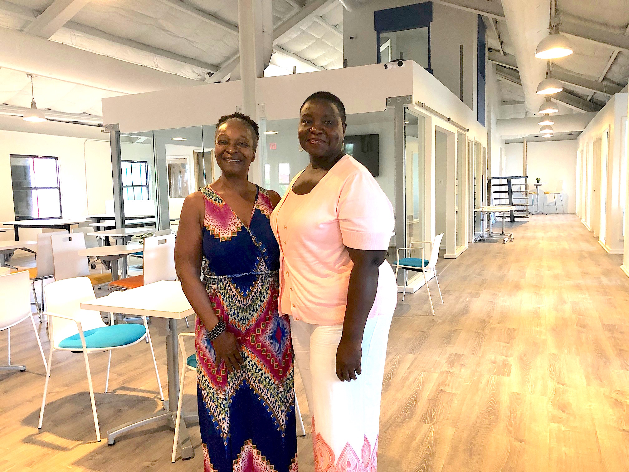 SEAT Caribbean co-founders Beverly Goodwine and Dr. Jennifer Sequeira invite residents and visitors to visit the new downtown facility. Not shown: co-founder Sonja Sulcer.