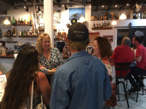 Valerie Sims greets guests at a book signing held at Bajo El Sol last Saturday. (Source photo by Amy Roberts)