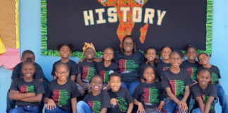 Students on St. Thomas wear their V.I. History shirts on Feb. 28. (V.I. Department of Education photo)