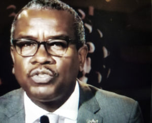 Gov. Albert Bryan Jr. announces the territory's phased reopening plan. (Photo is a screen capture from the press conference)