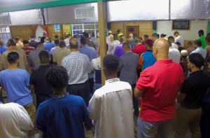 Local Muslim men come together as one to prayat Masjid Nur. (Source photo by Nour Z. Suid)