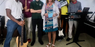 Street Level V.I. founder Priscilla Lynn presents donation to Gifft Hill School on St. John. From left to right is: music teacher Dennison Blackett, and students Eion Roberts, Christian Foust, Ohsemenard Vales, A.J. Phillips and Ricquan Charlemagne. (Photo provided by Gifft High School)