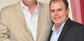 David Johnson, left, and Kirk Chewning, founders and co-owners of Cane Bay Partners, receive the St. Croix Chamber of Commerce's 2019 Nonprofit of the Year Award on behalf of Cane Bay Cares, the charity arm of Cane Bay Partners. (Photo from Cane Bay Partners website)